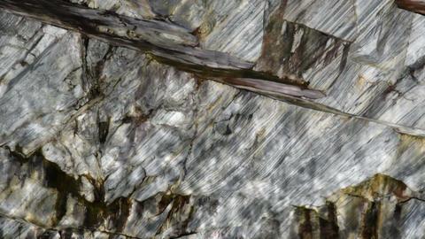 Sunbeams on marble rock Footage