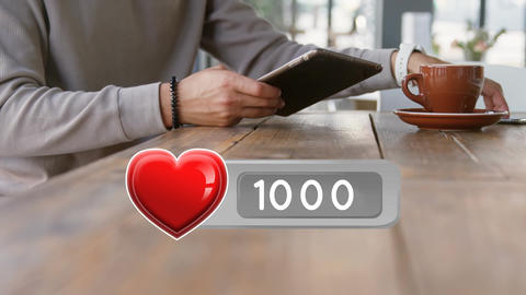 Heart icon and a man using digital devices Animation
