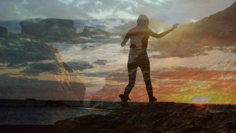 Woman climbing rocks beside ocean Animation
