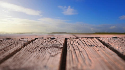 Wooden deck with a view of blue skies Animation
