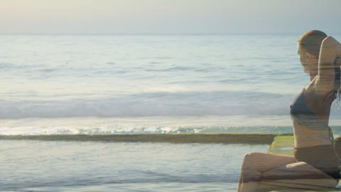 Woman resting on a seawall watching the waves 4k Animation