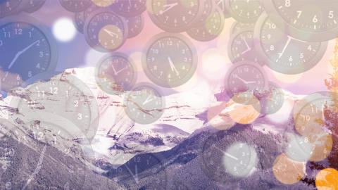 Snowy mountain with background of clocks and bokeh lights Animation
