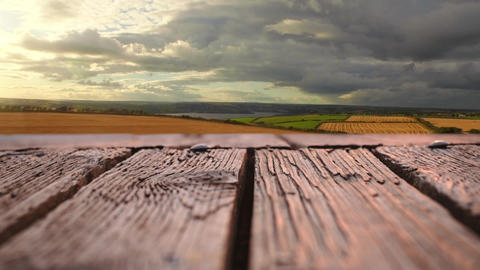 Wooden deck with a view of wide open fields Animation