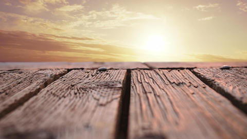 Wooden deck with a view of a sunset Animation