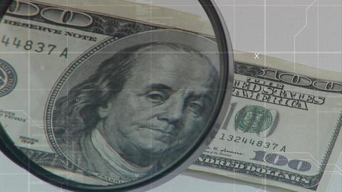 Magnifying lens on a hundred dollar bill Animation