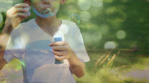 Little boy blowing bubbles in the park Animation