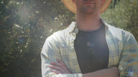 Man wearing a straw hat in the countryside Animation