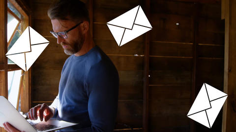 Man typing on a laptop in the attic 4k Animation