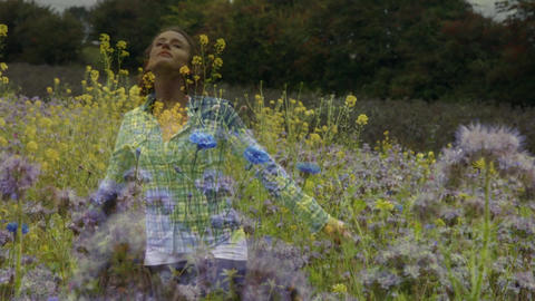 Woman dancing on a field of flowers Animation