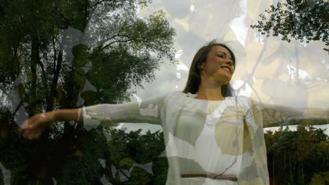 Woman in white dress spinning in a forest Animation