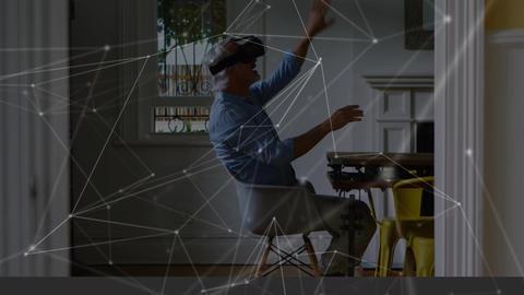 Old man having fun wearing a virtual reality headset Animation