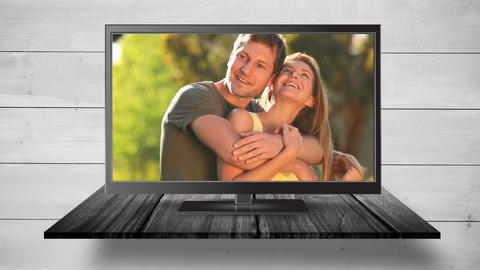 Television with happy couple on its screen Animation