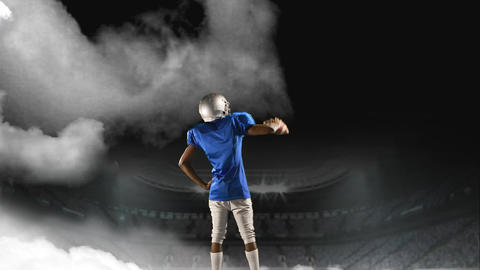 American football player standing on a foggy field stadium Animation