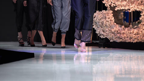 Female models walk the runway in different dresses during a Fashion Show. Fashion catwalk event Live Action