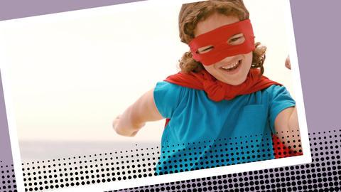Little girl wearing a superhero costume on the beach Animation