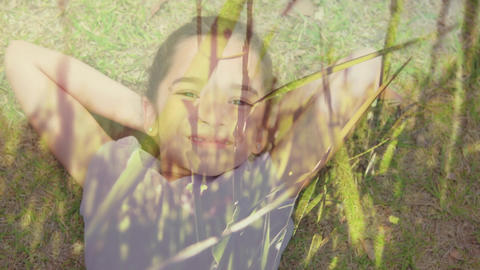 Little girl lying on grass smiling Animation
