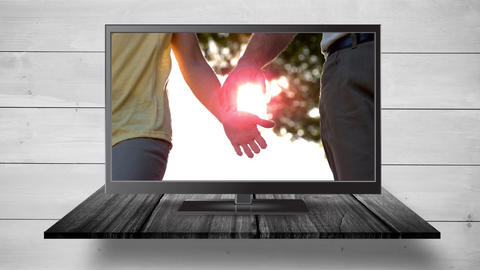 Television with holding hands on its screen Animation
