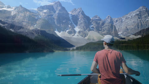 Man boating in a lake and a view of the mountain Animation