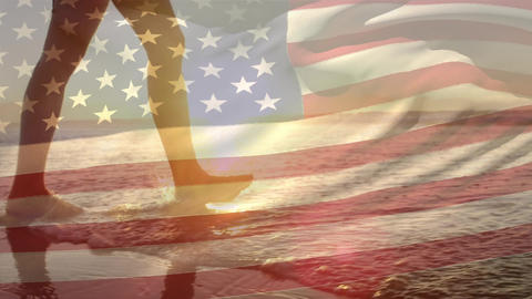 Woman walking by the beach and the American flag for fourth of July Animation