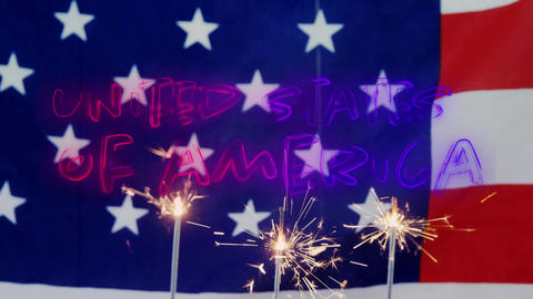 United States of America text and American flag behind cupcakes with a sparkle Animation