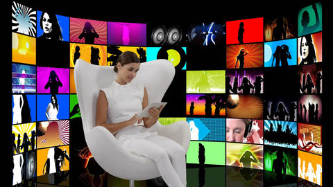 Woman sitting in a white chair and videos on screens Animation