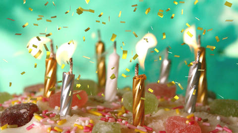 Candles on a birthday cake and confetti Animation