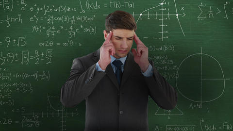 Man thinking in front of moving maths calculations on chalkboard 4k Animation