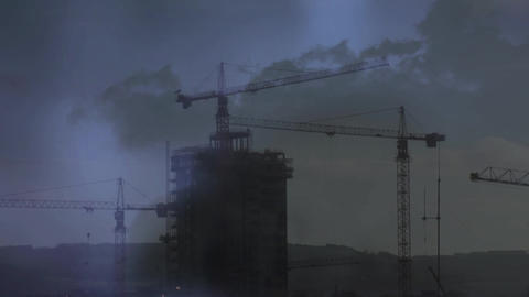 Cranes on top of a building and lightning Animation