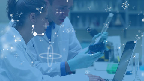 Scientsis working in lab with floating white molecules in foreground Animation