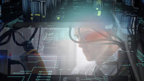 Close up of man working on mainframe computer while circuit board moves in foreground Animation