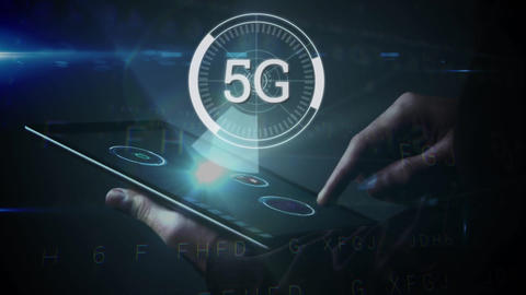 5G displayed in a circle with person using tablet in the background Animation