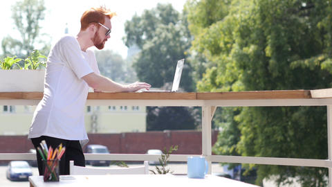Busy Working on Laptop, Standing in Balcony of Office Outdoor, Gesture Footage