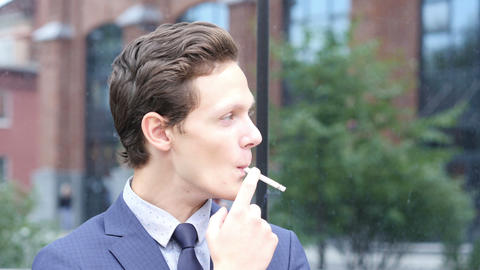 Portrait of Businessman Smoking Cigarette Footage