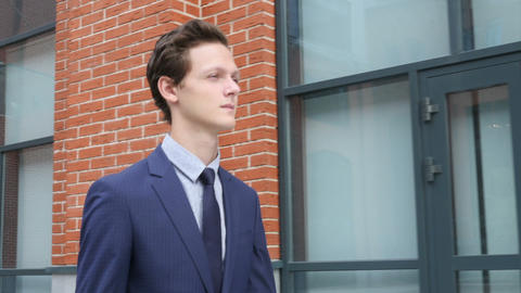 Walking Pensive Young Businessman Footage