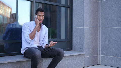 Attending Phone Call, Talking while Sitting Outdoor Footage