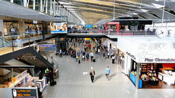 Schiphol airport, departures terminal main hall with travelers passing by Footage