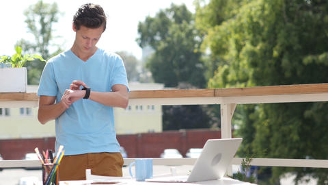 Sunny Day, Man Standing and Using Smartwatch in Balcony, Gadget Footage
