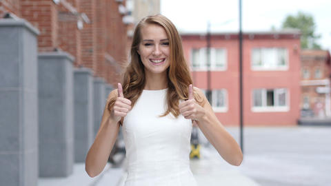 Thumbs Up by Beautiful Young Girl, Standing Outdoor Live Action