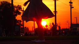 Flying high skirt against bright sunset, happy girl spin, legs view Footage