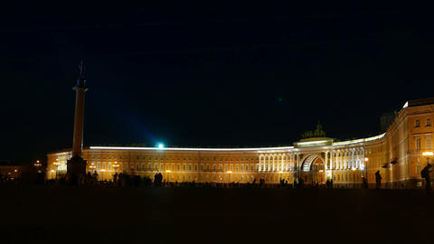 Crowded Palace Square at night, time lapse of people silhouettes walk around Footage
