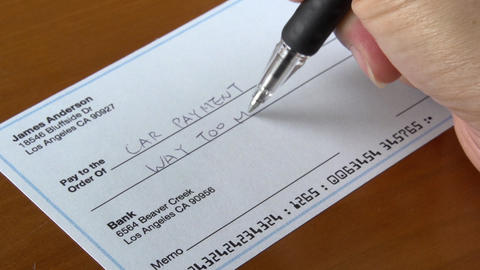 Close up shot of someone filling out a check Live Action