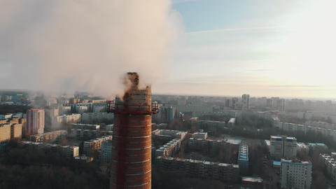 Air pollution problem - a big industrial pipe pollutes the air in the city Live Action
