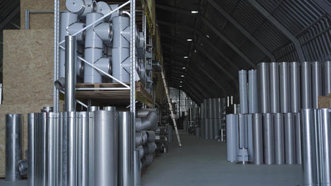 Steel metal chimneys and pipes standing stored in warehouse. Steel industry Live Action