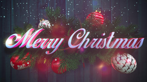 Animated closeup Merry Christmas text, white snowflakes, green Christmas branches on wood background Animation