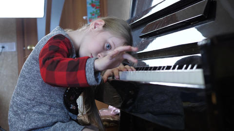 Child Tired of Learning Piano Live Action