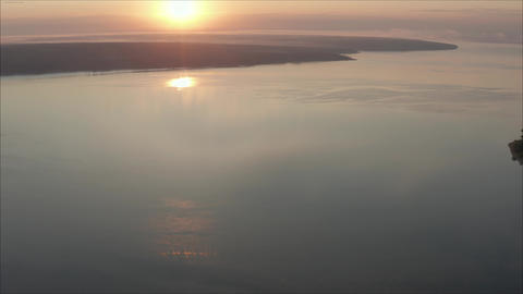 Beautiful lake at sunset. A plane flies over the lake. Cool beautiful shots Live Action