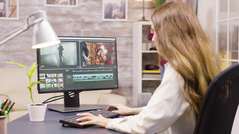 Creative female filmmaker working on post production of a movie Live Action