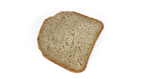 slice of homebaked bread rotating at white background Footage