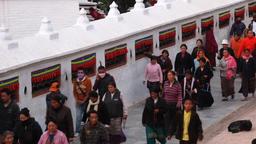 Tibetan Buddhist pilgrims walk around Boudha Stupa in Kathmandu Nepal 2009 Footage