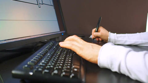 Tablet 27. Close up of the hand of a engineer editing scheme in CAD system, sign Footage
